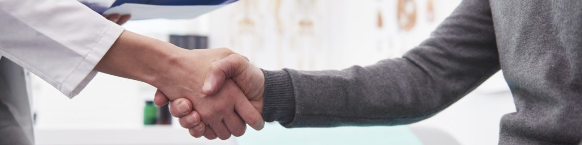 Detail of handshake of doctor and patient.