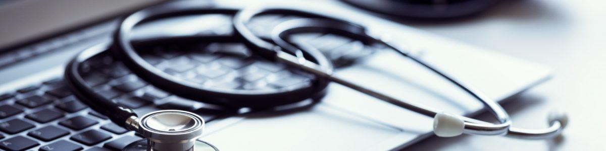 stethoscope-on-laptop-keyboard-in-doctor-surgery-VRJFAYK.jpg